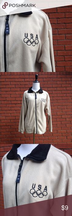 Vintage Olympic Fall Jacket Size Medium, Olympic Authentic vintage 1990s Olympic Team USA sweater jacket.  This jacket is light brown cream tan color and features the Olympic logo. It was made in the USA. It's in excellent condition and shows no signs of wear.   Size medium.  Tags: Olympics, Team USA, Atlanta, Rio, Fall, 90s, 1990s, 1980s, 80s, vintage sweater Vintage Jackets & Coats Utility Jackets