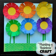 """Cupcake Liner Flower Garden Craft to go along with book """"Planting a Rainbow"""" by Lois Ehlert."""