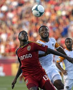 Houston Dynamo's Jermaine Taylor, left, and Real Salt Lakes' Olmes Garcia (13) go after a ball in the first half during an MLS soccer game, Saturday, Aug. 10, 2013, in Sandy, Utah.  (AP Photo/Rick Bowmer)