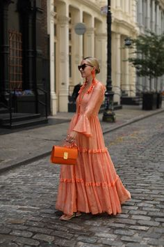 ORANGE SHERBET // SUNSET SHADES Sunset Shades // Blair Eadie wears an orange maxi dress by Kukhareva, earrings by Dinosaur Designs, and a Flynn bag // Click through to Atlantic-Pacific for more images as well as Blair's orange picks for summer! Look Fashion, Spring Fashion, Womens Fashion, Fashion Trends, Fashion 2020, Runway Fashion, Boho Dress, Dress Skirt, Summer Outfits