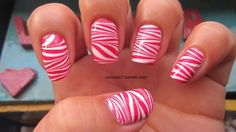 pink and white swirl-You could do this by painting a white base and maybe 3 narrow red stripes an swiping the polish back and forth while it's wet.  So cute!