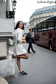 Womenswear Street Style by Ángel Robles. Fashion Photography from Paris Fashion Week. White mini dress and Balance sneakers.