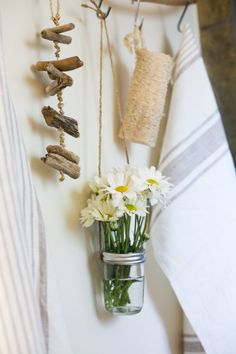 Whitney and Adam's Live/Work Canal Cottage: love the holes in jar lid to support flowers