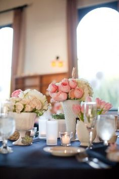 Pink peonies, milk glass, and navy table cloth wedding table