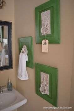 large vintage hardware mounted onto a cabinet door makes a great hanger for a hand towel
