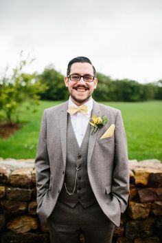 A Vintage Wedding with Rustic Hints at The Out Barn. Groom wearing grey suit and yellow bow tie. Image by Hip to Heart Photography. Read more: http://bridesupnorth.com/2016/08/08/lucky-day-a-rustic-vintage-wedding-at-the-out-barn-rebecca-scott/ #wedding #groom