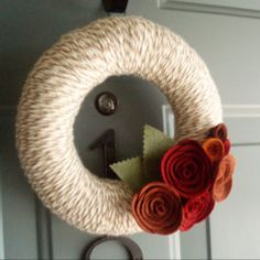 Fall yarn wreath with felt flowers