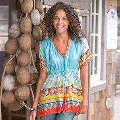 A soft silk tunic with a tribal beat and a blue as cool and beckoning as tropical waters. What could be more lovely