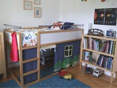 "The first thing you might notice about this KURA is the fun ""house"" curtains that make it a fun playhouse, but a more interesting modification is the addition of safety bed rails. Bunk Beds Canada, Bunk Beds Uk, Futon Bunk Bed, Wood Bunk Beds, Kid Beds, Bed Mattress, Lofted Beds, Ikea Bunk Bed Hack, Ikea Kids Bed"