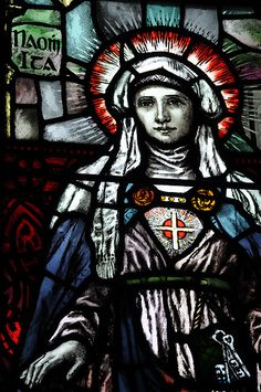 January 15th Saint Ita.    Ita was reputedly of royal lineage. She was born at Decies, Waterford, Ireland, refused to be married, and secured her father's permission to live a virginal life. She moved to Killeedy, Limerick, and founded a community of women dedicated to God. She also founded a school for boys, and one of her pupils was St. Brendan. Many extravagant miracles were attributed to her (in one of them she is reputed to have reunited the head and body of a man who had been beheaded…