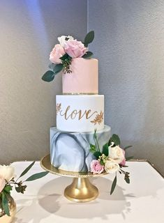 Marbled wedding cake with hand painted rose gold calligraphy and blush pink accent tier. Image copyright Carla Schier.