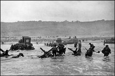 Normandy France 1944 by Robert Capa - June 6, 1944 - American soldiers landing on Omaha Beach, D-Day (c) Magnum Photos