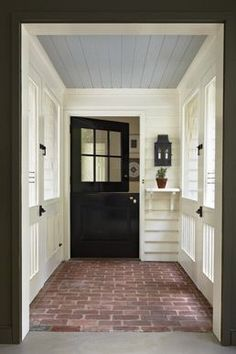 Covered screened porch with black farmhouse style entry door Brick flooring whit. Covered screened porch with black farmhouse style entry door Brick flooring white siding and blue b Style At Home, Modern Farmhouse, Farmhouse Style, Modern Porch, Farmhouse Decor, Farmhouse Renovation, Farmhouse Flooring, Porch Ceiling, Blue Ceilings