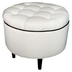 Whether you want to update your living room or refresh your master suite dcor, give your home a stylish uplift with this beautiful design. Product: OttomanConstruction Material: Wood and upholstery fabricColor: White    Features:  Tufted design   Dimensions: 19  H x 23  Diameter    Shipping: This item ships small parcelExpected Arrival Date: Between 04/14/2013 and 04/22/2013Return Policy: This item is final sale and cannot be returned