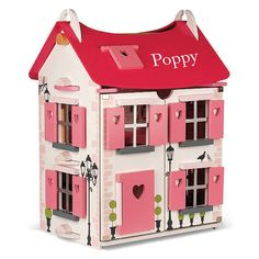 A delightful Children's Dolls House. A fantastic gift for Christmas.We can personalise this item with your child's name in vinyl lettering to make the gift extra special. Just choose the option from the drop down menu.A superbly crafted wooden dolls house. Complete with accessories, this two storey dolls house really is a forever toy, The front of the house opens up fully to give access to the beautifully decorated rooms, a pretty spiral staircase and the attic room. The house comes with 17…