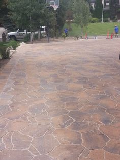 Belgard Paver driveway getting sealed with lifetime from Concrete color and Design