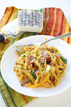 Butternut squash is spiralized into noodles and then tossed with sautéed onions, bacon, fresh spinach, and creamy mascarpone cheese.