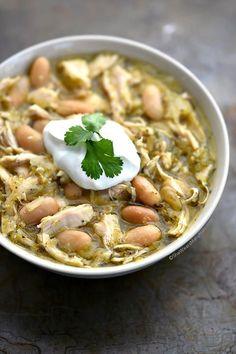 Verde Chicken Chili Recipe This easy Verde Chicken Soup Recipe is so flavorful and healthy too! Made with salsa verde, chicken and white beans a bowl of this soup is a tasty way to end a chilly day. | shewearsmanyhats.com