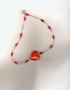 CHEAPLY PRICED. $12.50. FREE NECKLACE WITH EVERY PURCHASE!  Silver-Plated Necklace / Delica Beads / Glass Beads.  Has a Lampwork Glass Puff Heart Pendant (Puff means three dimensional. https://www.etsy.com/ca/shop/JehovahJJewellery?ref=si_shop