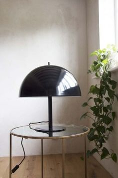 A slightly shorter table lamp this light would also be a good desk lamp. With a shorter base and shiny black dome for a shade, the Mushroom Lamp is very chic. Best Desk Lamp, Rockett St George, Wall Lights, Ceiling Lights, Light Table, Lighting, Mushroom, Modern Table, Table Lamps