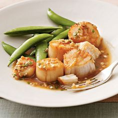Pan-Roasted Scallops with Sesame Sauce Recipe Main Dishes with sea scallops, green onions, garlic cloves, low sodium soy sauce, rice vinegar, sugar, corn starch, sesame oil, crushed red pepper, canola oil, black pepper