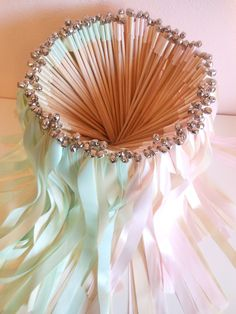Instead of throwing rice, etc. We could have these... Wedding Wands - 100 double ribbon wands with bells. $125.00, via Etsy.