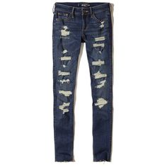 Hollister Shredded Low-Rise Super Skinny Jeans ($60) ❤ liked on Polyvore featuring jeans, destroyed dark wash, faded skinny jeans, zipper skinny jeans, torn skinny jeans, blue skinny jeans and frayed hem jeans