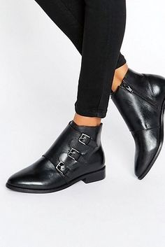 Black booties with buckle details.   17 Gorgeous Boots You'll Want To Wear All Winter