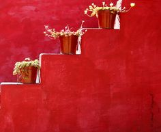 red stucco wall with staircase