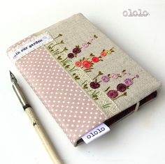 Hand emboidery.. Notebook cover of linen and cotton fabrics - Garden with flowers