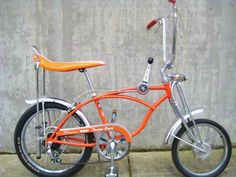 1970 Schwinn Sting Ray Orange Krate bicycle on display at Classic Cycle, a bike shop on Bainbridge Island, located near Seattle, Poulsbo, and Silverdale Old Bicycle, Bicycle Pedals, Old Bikes, Bicycle Wheel, Gi Joe, Raleigh Chopper, Chopper Bike, Cool Bicycles, Vintage Bicycles