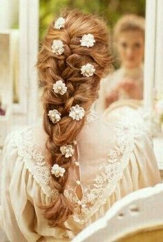 Fairytale Princess Hairstyle. I love the touch of flowers in the hair!