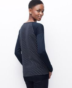 bccc31db1d4 Mix master  add instant interest to your look in this knit front top