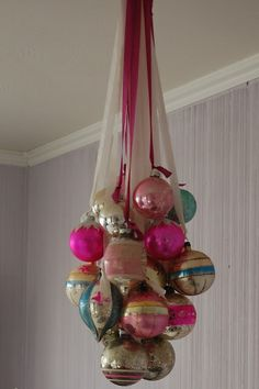 Old Christmas balls hung with ribbons. I have a whole box of my grandparents ornaments - now I know what to do with them!