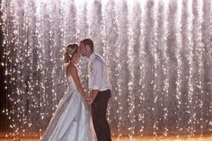 The firework waterfall creates a stunning backdrop for wedding pictures