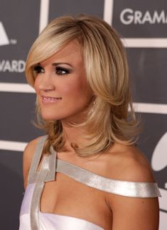Side swept bangs, shoulder length hair with face framing layers