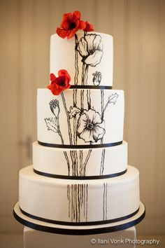 How beautiful is the contrast of the red poppies against this black and white hand painted cake? Belle's Patisserie