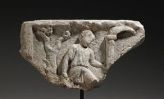 A ROMAN MARBLE RELIEF FRAGMENT     CIRCA 2ND-3RD CENTURY A.D.