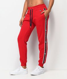 Equal parts cozy and sporty, the Logo Tape red jogger sweatpants from Tommy Hilfiger are here to complete your athleisure style. These bold red sweatpants feature a jogger silhouette with a drawstring waistband. An embroidered Tommy logo is added to the l Cute Sweatpants Outfit, Red Sweatpants, Red Joggers, Sweat Pants, H M Outfits, Cute Swag Outfits, Hip Hop Outfits, Preppy Outfits, Stylish Outfits