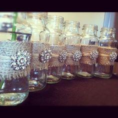 Rustic Glass Vases for Weddings w/ Burlap & Jute/Twine Ribbon and Crystal Rhinestone Charm Brooch-Set of 12. $120.00, via Etsy.