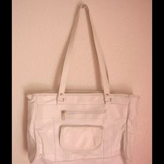 Super Cute White Handbag This purse is really cute and it matches with anything, it also has various compartments. One Size Bags
