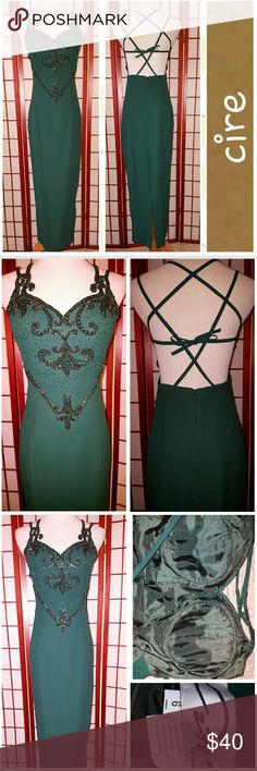 Prom Dress! Beautiful prom dress by Cire.  Dark green.  Backless.  Full length.  Padded bust.  Sz 6.  20in slit in back.  Measurements lying flat armpit to armpit 17in, waist 13in, length shoulder to hem 50in.  Great condition.  No stains or tears.  From smoke free home. Cire Dresses Prom