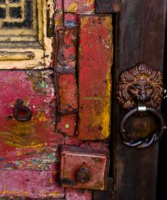 Love the colors, and the chipping paint on old wood. The lion door handle/knocker is nice too...