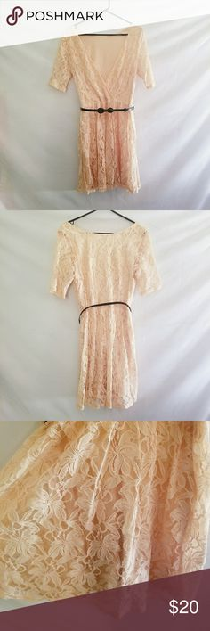 Floral Lace Dress with Belt Floral lace dress with shell and liner.  Removable belt with bow that has 5 holes for adjustment Hidden zipper on side  Shell: 55% Nylon 45%  Cotton Lining: 100% Rayon Forever 21 Dresses