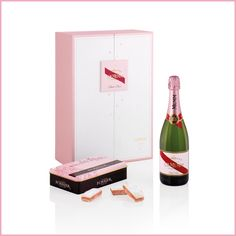 "Here is the very elegant box ""Légende de  Rosé"", it represents a perfect alliance between the fine and pleasant Brut Champagne and these delicious Mini Biscuits Roses de Reims, these bring a crunchy and creamy touch on my champagne tasting.. To Enjoy with my besties'"