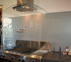 The Glass Backsplash Trend Is Spreading Like Wildfire Across Kitchen  Remodels, And For Good Reason.