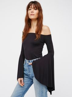 We The Free Birds Of Paradise Top   Sexy off-the-shoulder top featuring ultra dramatic flared sleeves.    * Stretchy fabrication