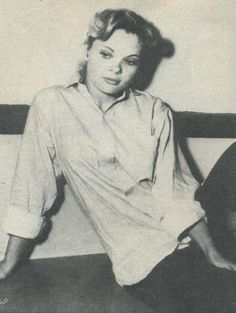 1956: charged with shooting ex-husband, Candy has first brush with Dallas jail.