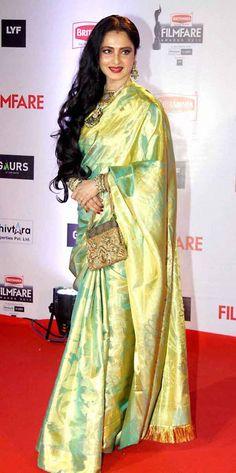 Veteran actor Rekha looked graceful as always in a pure silk Kanjeevaram saree Latest Indian Saree, Indian Sarees Online, Indian Beauty Saree, Indian Dresses, Indian Outfits, Rekha Saree, Golden Saree, Bollywood Designer Sarees, Simple Sarees