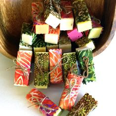 Youll receive 12 beautifully scented, assorted soaps wrapped in gorgeous, hand-dyed cotton batik fabrics. Choose your colorway - warms, cools, brights, earth tones, or a fun mix - and well wrap an assortment of soaps to match your decor. (These do not have printed labels.)    These